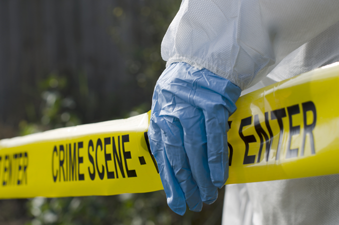 Police tape and crime scene cleaner